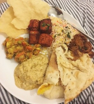 Popadoms, tofu tikka, rice, bhaji's, korma, cashew curry & peshwari naan.